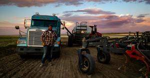 Farmer and MFU Member John Wicks stands in his farm field